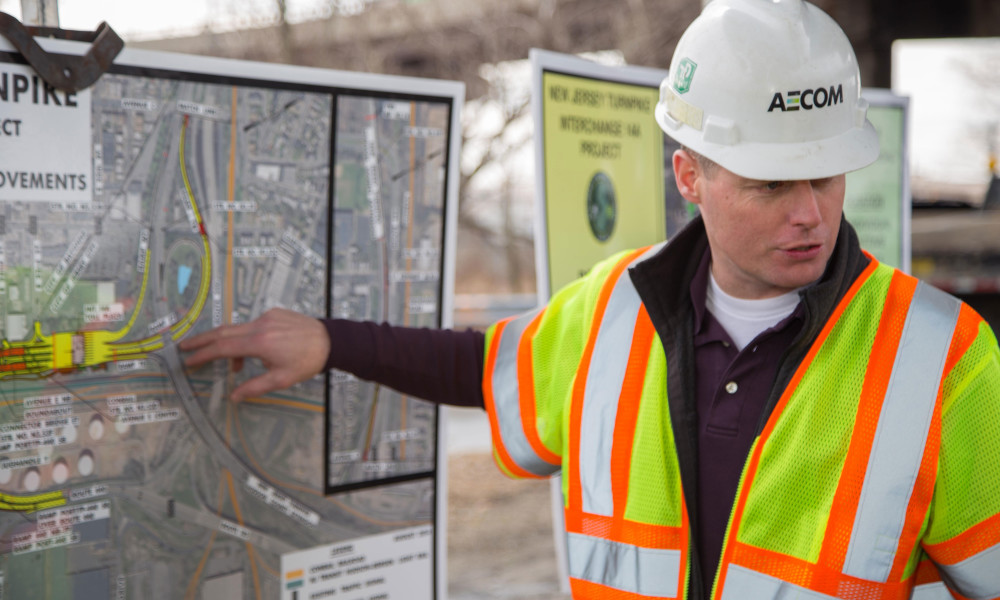AECOM Project Engineer, Tim Snow, explains the construction plans to groundbreaking ceremony attendees.
