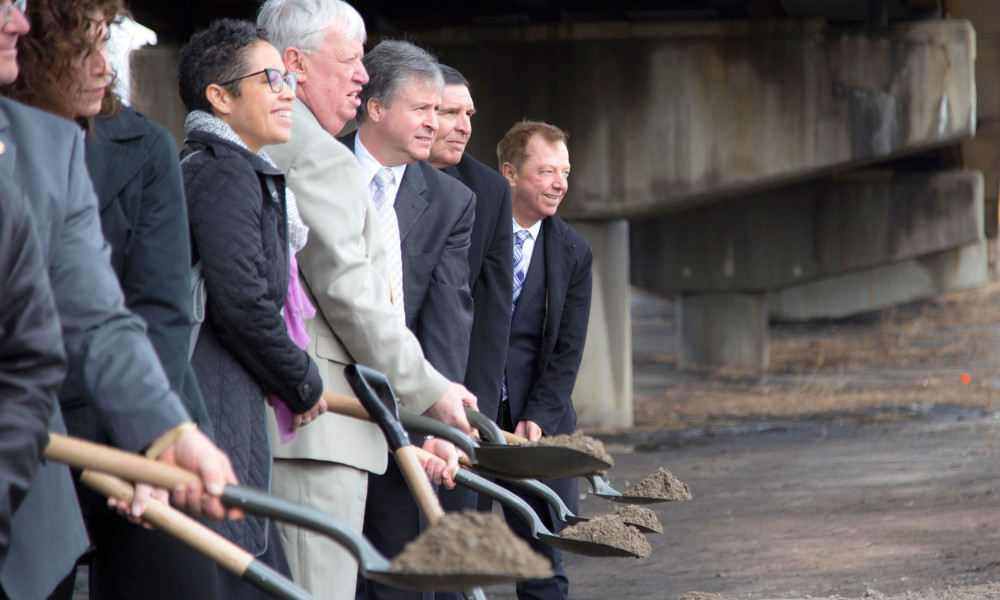 Representatives dig shovels full of dirt to kick-off the Interchange 14A Improvement Project.
